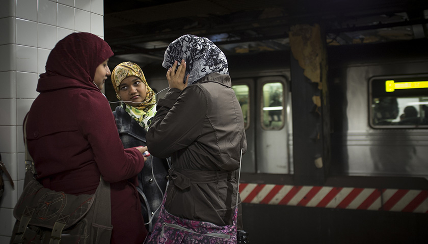 A small group of Muslim women wait for the subway.