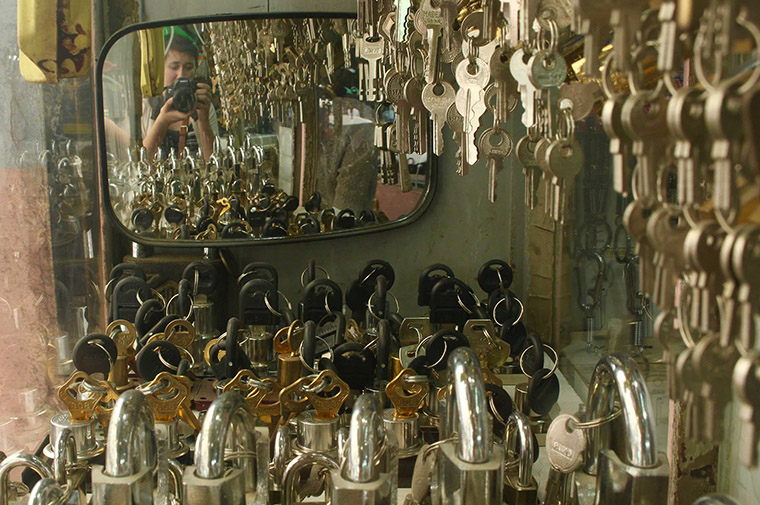 A self portrait of Janet captured in a small mirror, amongst many keys, at a stall in the bazaar.