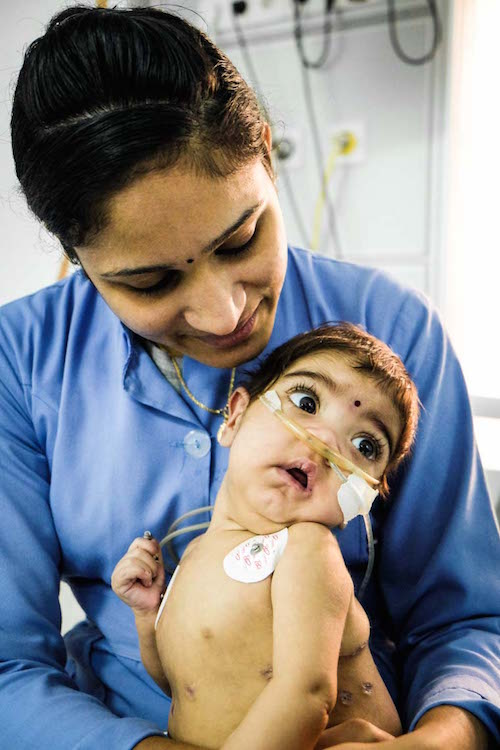 A photo of Zahraa with one of the nurses
