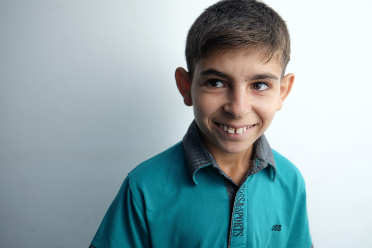 A photo of Hatem smiling
