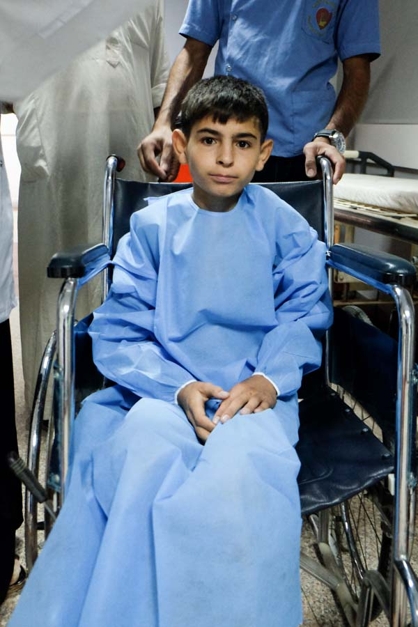 photo of Hatem being wheeled into OR