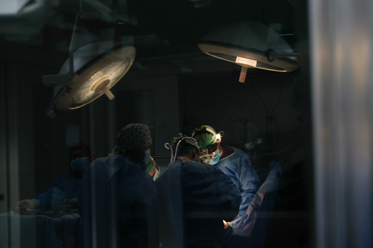 photo of doctors operating on Hatem