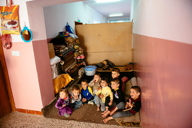 These Iraqi children, displaced by ISIS, have found temporary shelter in a school.