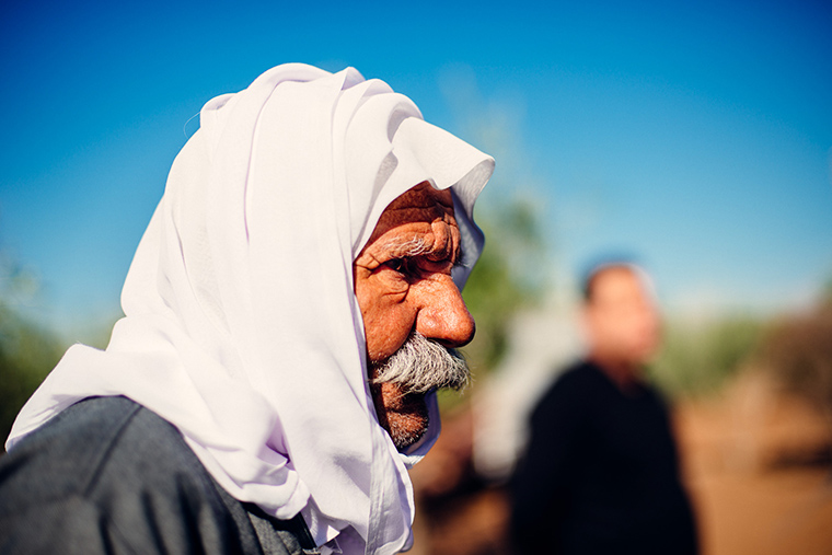An IDP in Iraq waits patiently for relief aid to be unloaded.