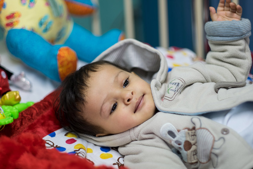 Young Muman gets great care from his nurse after his lifesaving heart surgery.