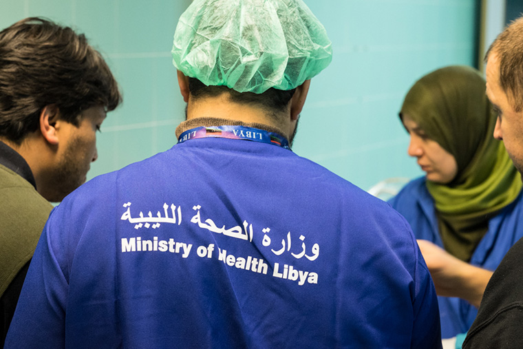 Hospital staff discuss the condition of patients, in Tobruk, Libya.