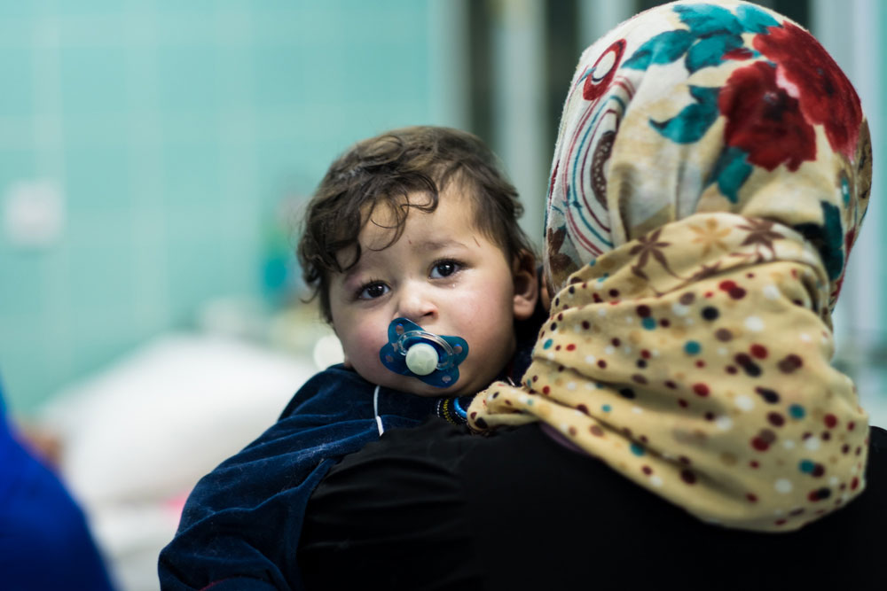 Little Sufyan sucks a pacifier and walks the halls with his mother, waiting for lifesaving heart surgery in Tobruk, Libya via Preemptive Love Coalition.