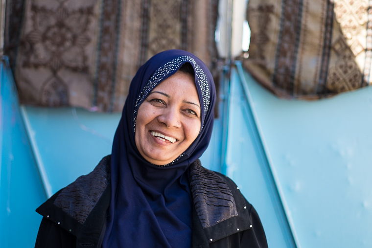 Abeer, a new business woman in Kirkuk, smiles with pride.