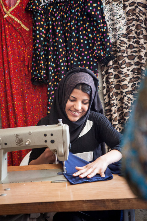 Sewing dresses for sale in their Iraqi community.