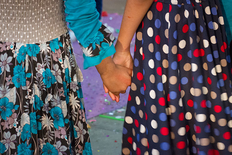 Girls at an Easter party, hosted by a local Assyrian church, hold hands.