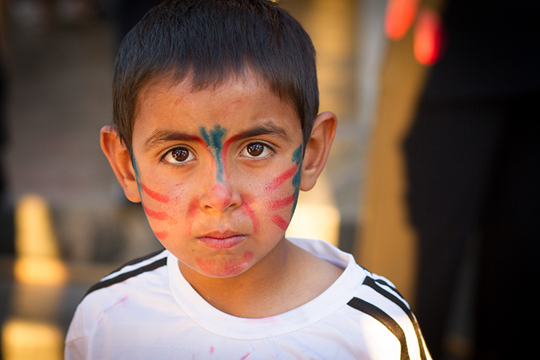 A young boy's face paint in nearly gone, after an energetic Easter party hosted by the local Assyrian church.