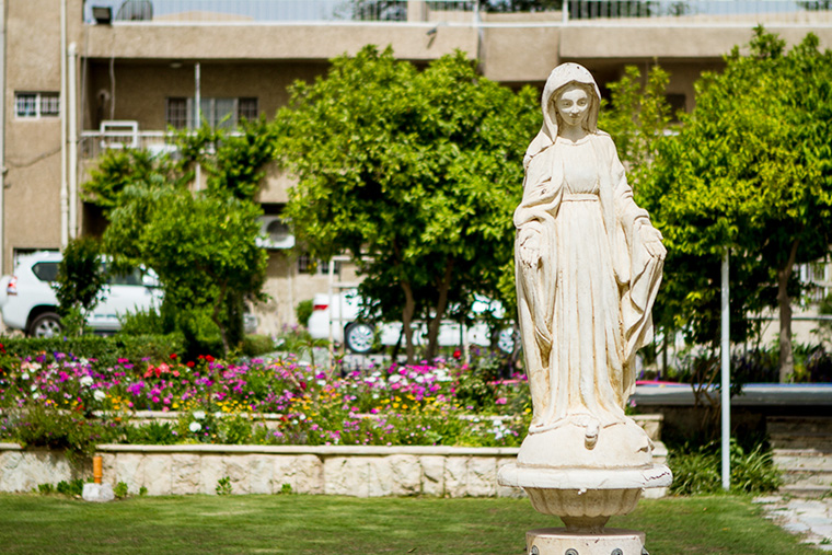 A statue of the Virgin Mary, in a garden in Baghdad.