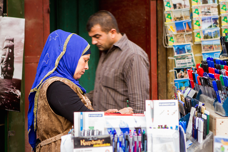 A woman inspects the selection of stationary supplies on offer.