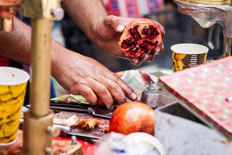 Pomegranates being prepared for juice, on Baghdad's Mutanabbi Street.