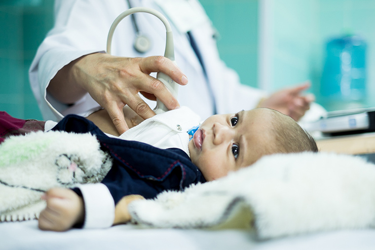 A tiny boy gets an echocardiogram in Libya, to detect a congenital heart defect.