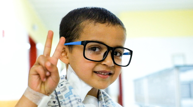 Hamam stops for photos, and wears a nurses's glasses for the photo.