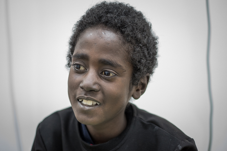 Ramadan with a rare smile on his face.