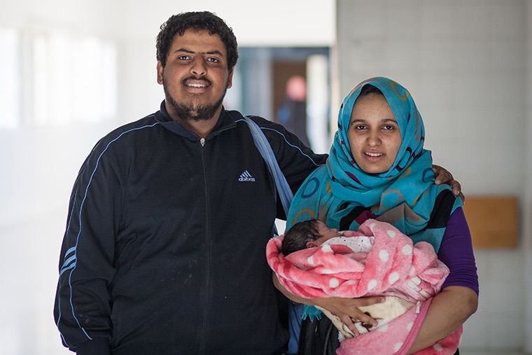 Mohammad's mom and dad pose with their new baby girl.