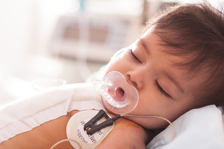 Esam sleeps after his lifesaving heart surgery.