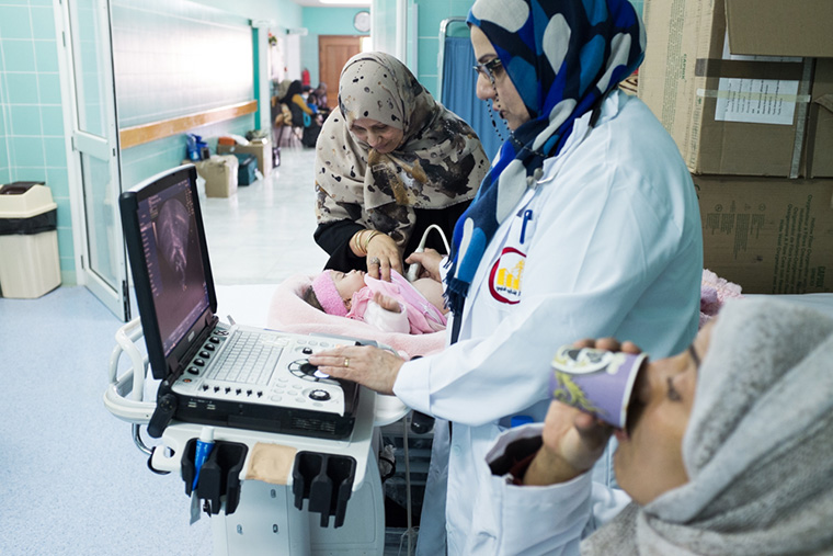 Dr. Rasmia performs an echocardiogram on a child, to detect heart defects.