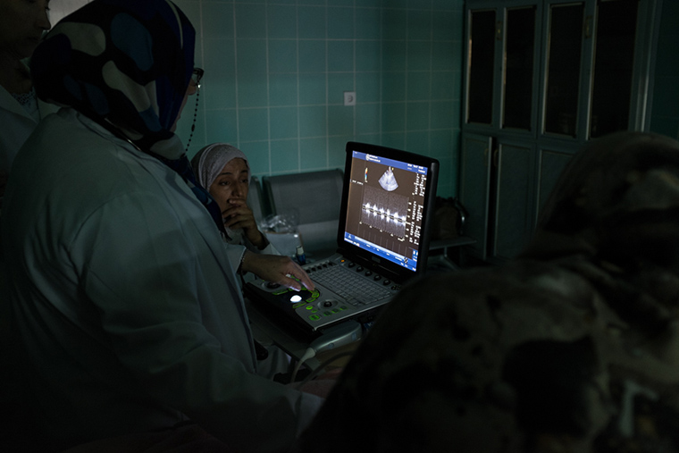 Cardiologists training in the Libya program gather to consult on a patient diagnosis.