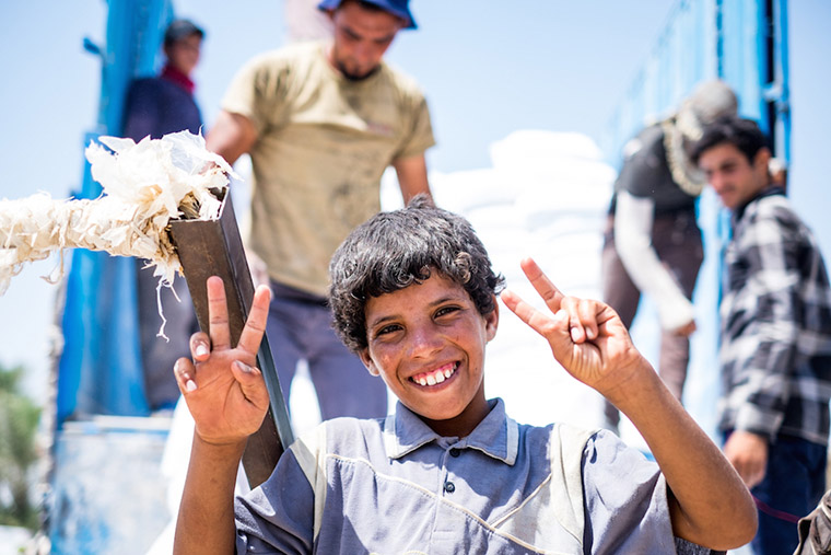 One of the boys who makes their living hauling supplies to displaced families, across the Bzebez bridge, Iraq.