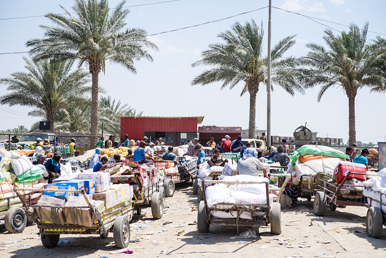 Hundreds of cargo carts are lined up, waiting for permission to pass the Bzebez bridge, into Anbar, Iraq.