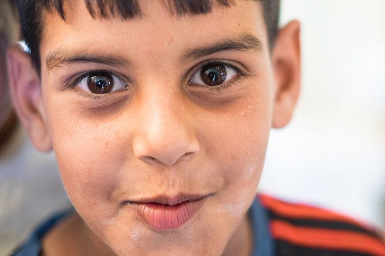 A young boy, displaced from the Anbar Province of Iraq by ISIS, seen by a doctor because of a skin issue.