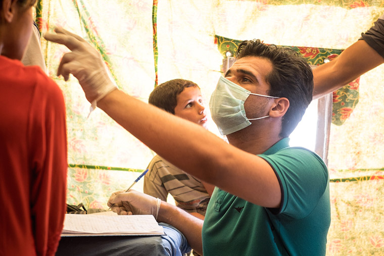 Dr. Nasir assesses displaced residents from Anbar Province, Iraq.