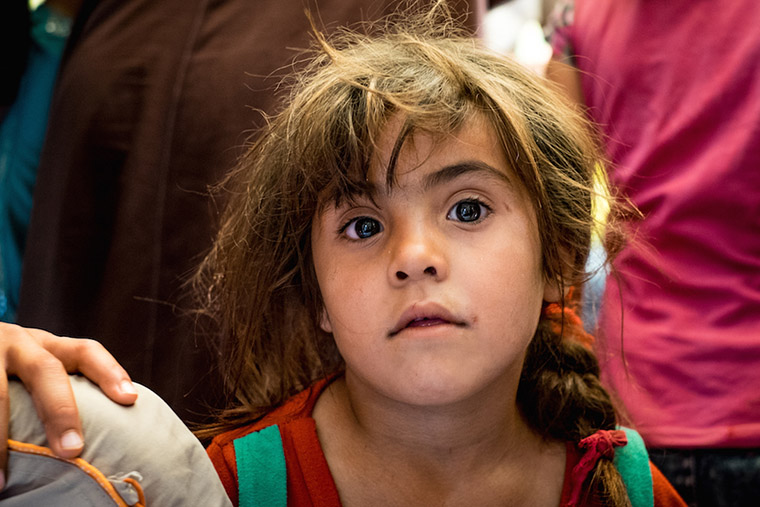 A young, displaced girl seen at the medical clinic. Families received emergency relief aid, water tanks, and medical care.