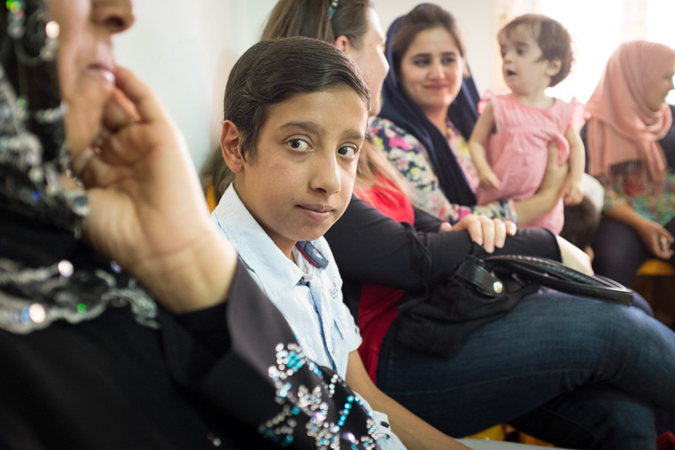 Ali sits in the waiting room, for his turn for a check-up after his lifesaving heart surgery.