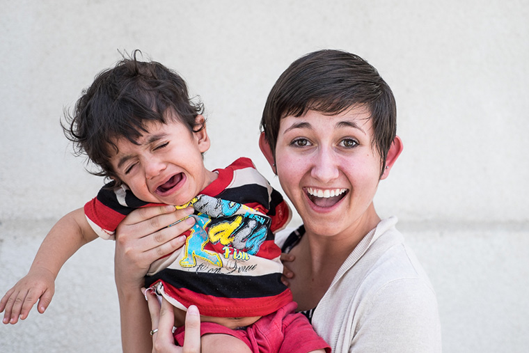 Summer intern Janet Eckles holds a young heart patient...who wasn't feeling very patient!