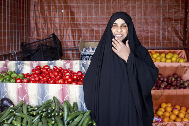 A photo of Madeeha at her vegetable shop in Baghdad