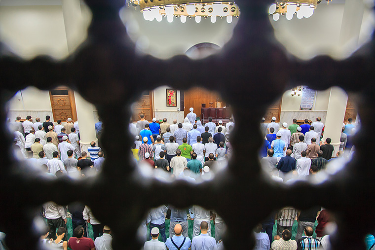 The first Taraweeh  Worshippers gather to pray the first night prayer at a mosque in Doha on the eve of Ramadan in 2013 by Omar Chatriwala