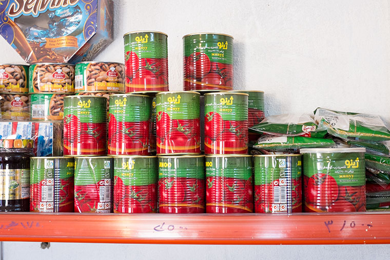 Products neatly line the shelves in Abeer's shop.