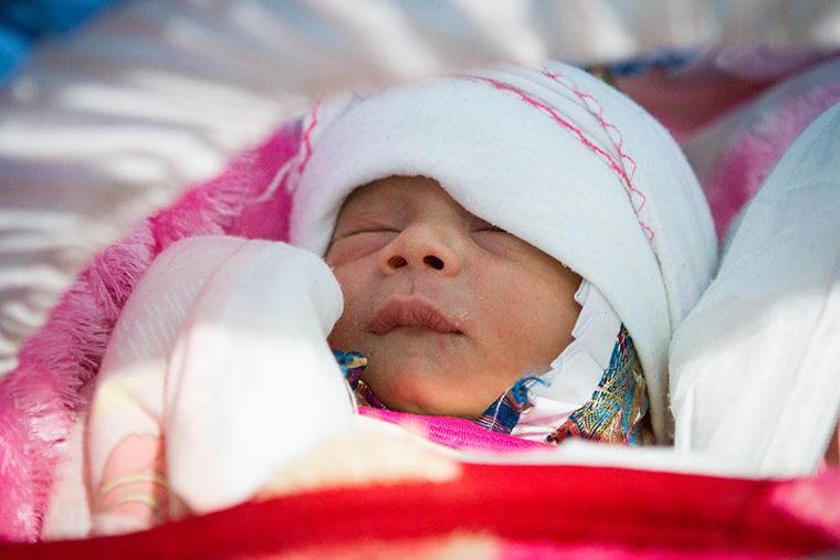 Aram, a baby born to a displaced Yezidi family, in Kurdistan.