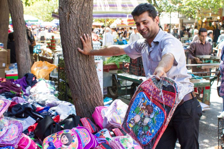 Helping Iraqi children displaced by ISIS choose backpacks.