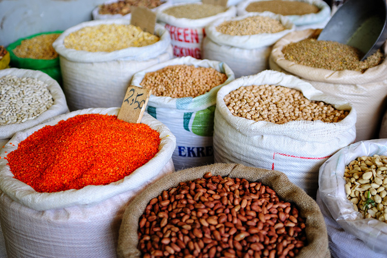 Tall bags of dried beans and lentils are on display for shoppers at the bazaar in Banghazi, Libya.