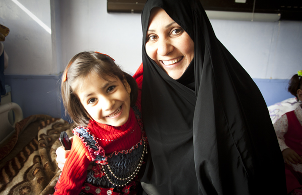 A heart patient and her mother, both with huge smiles.