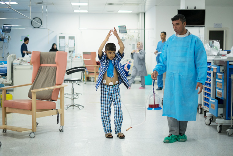 Young Mohammad walks the ICU with his father in Nasiriyah, Iraq after receiving the 1000th heart surgery through Preemptive Love Coalition.