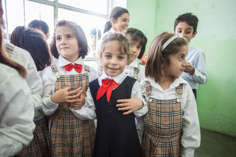 Deeya and her friends, dressed in their school uniforms, hold hand and smile. None of this would be possible without Deeya's lifesaving heart surgery.