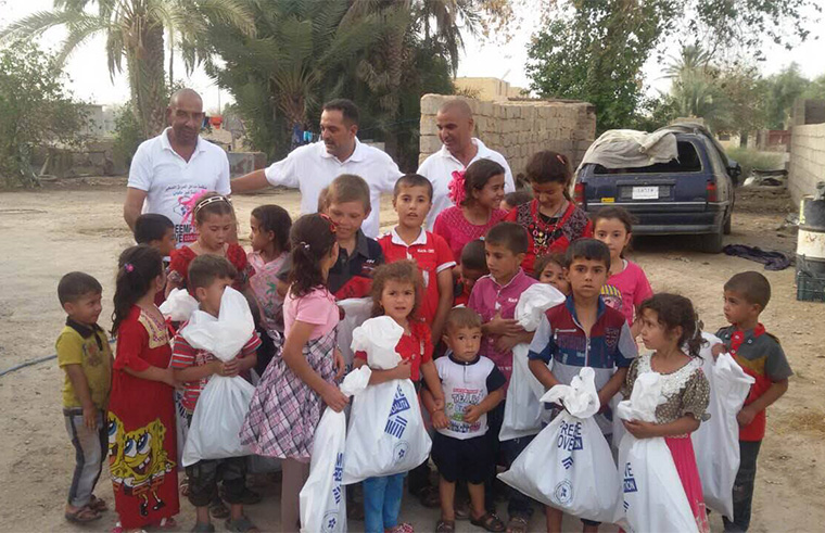 The local volunteer team gathers the children from a couple neighbouring houses and gives them gifts for Eid al Adha.