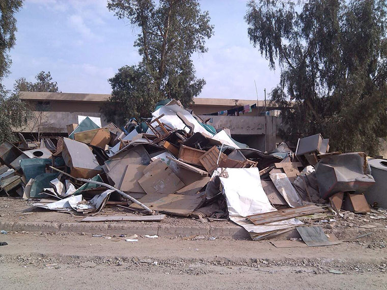 The heap of garbage removed from an abandoned school in Bagdad.