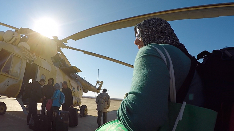 Medical staff board a helicopter, ready to fly into Libya.