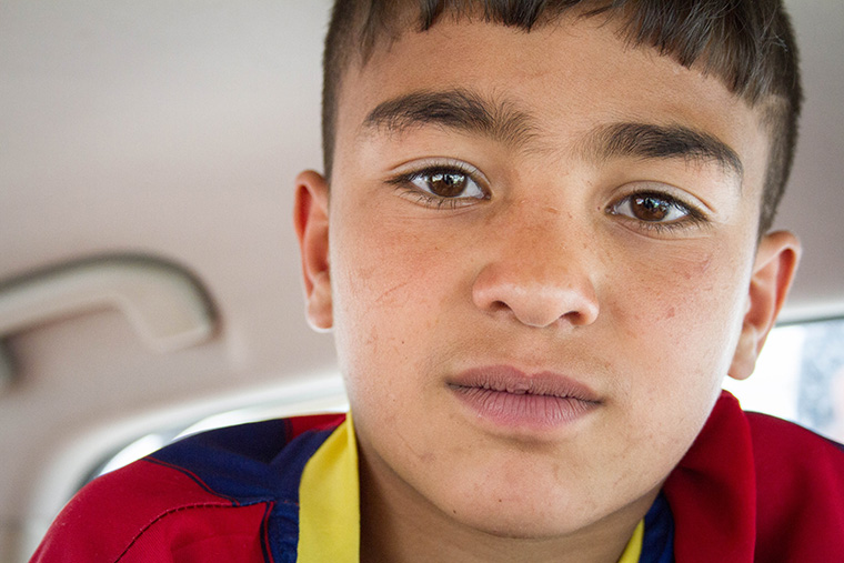 Mohammad strikes a serious pose for the camera, even though he's usually smiling.