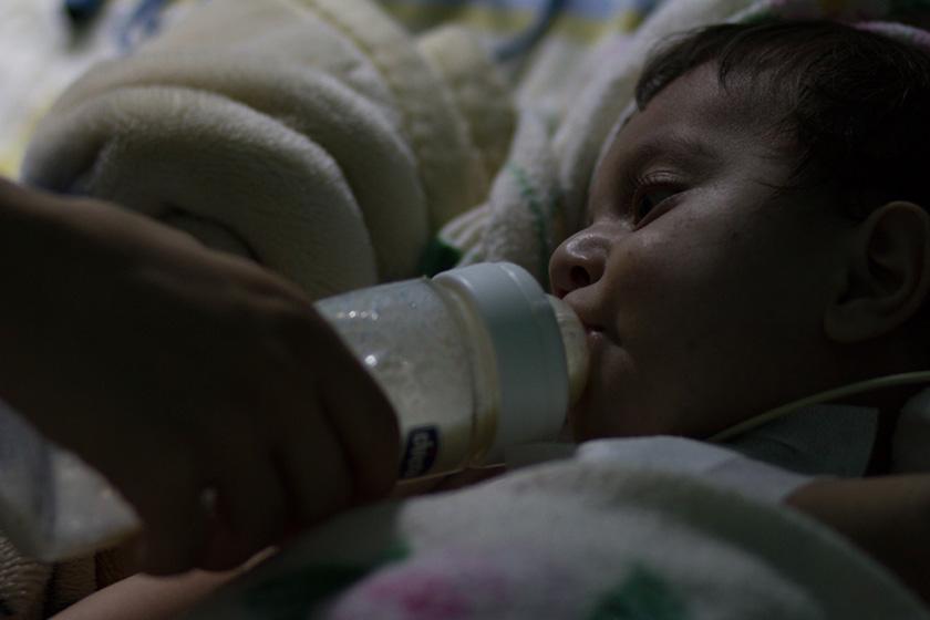 Muttah's mom feeds him a late-night bottle.