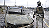 A member of the Iraqi security forces walks past a destroyed vehicle belonging to Islamic State militants during an intensive security deployment on the outskirts of Samarra, Dec. 14, 2014.  Read more: http://www.al-monitor.com/pulse/originals/2015/01/iraq-sunni-shiite-tension-samarra.html#ixzz3QP60QJ00
