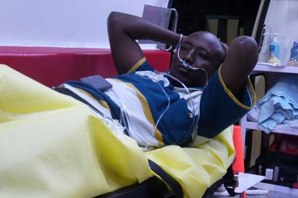 A photograph of Salah Farah on his hospital bed in Nairobi.
