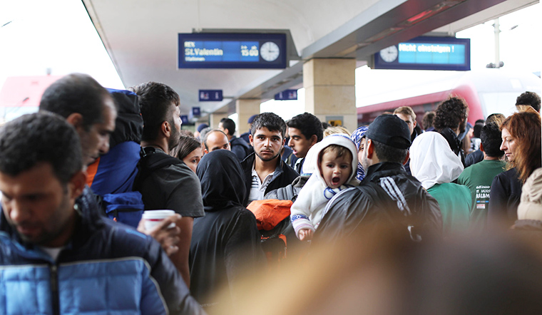 Syrian refugees wait for a train in Vienna, Austria.