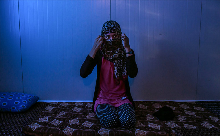 A woman, who said she was raped by Islamic State militants, in a refugee camp in the Kurdistan region of northern Iraq. Credit Mauricio Lima for The New York Times